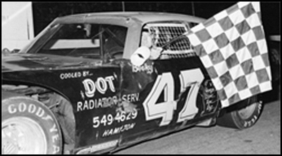Ralph Book #takes the Checkers at Flamboro Speedway. Photo By Tex