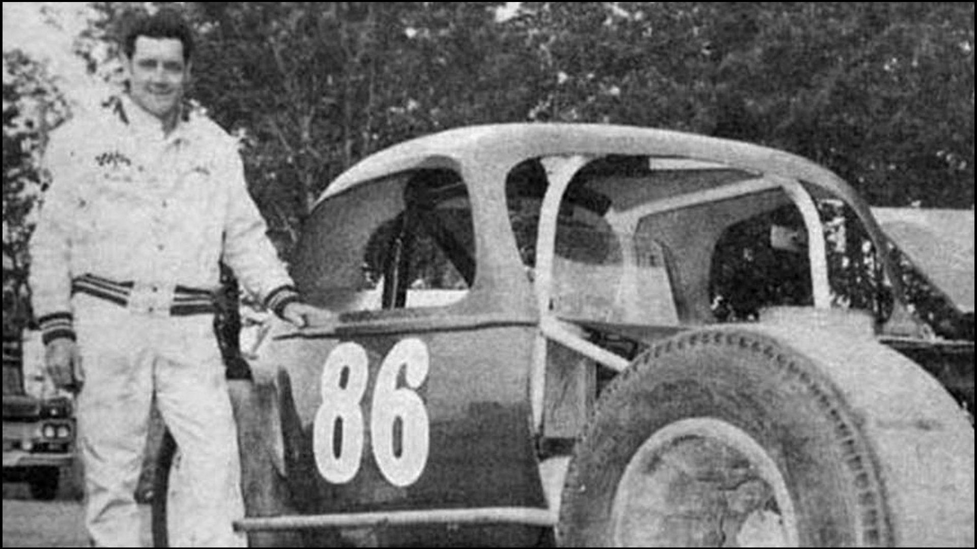 Norm-Mackereth-86-poses-with-the-Sportsman-Class-Modified-he-races-at-Fulton-Speedway.-Courtesy-of-Glen-Tustin
